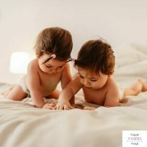 Twin babies playing on a bed. In this section you will find help for twin babies and twin toddlers.